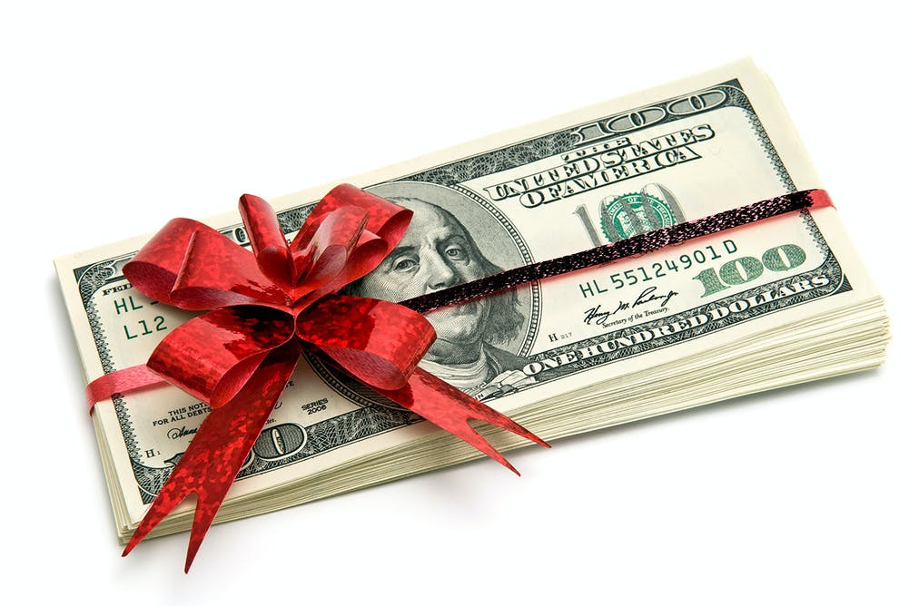 Give and take the anxiety of gift giving at christmas a gift of cash may be just the right thing cash gift via shutterstock negle Image collections