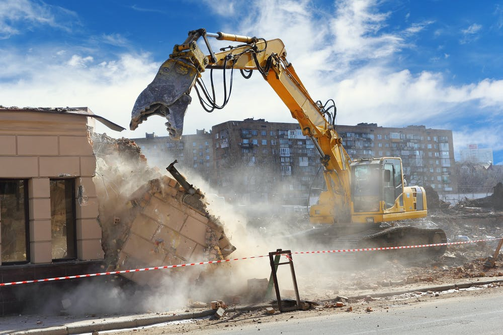 Why might a building unexpectedly collapse during demolition work?