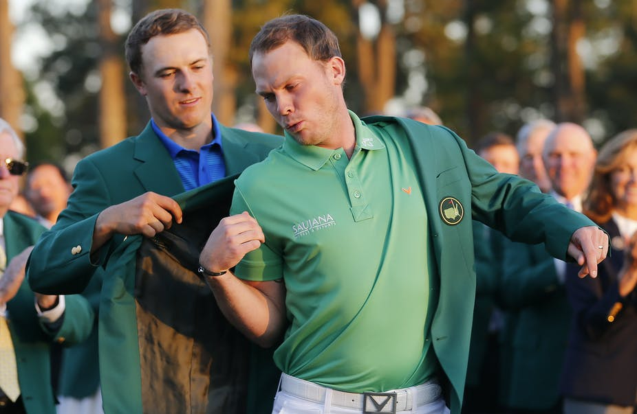 10cab73f788 Spieth having to help David Willett on with his green jacket for the  world's cameras.