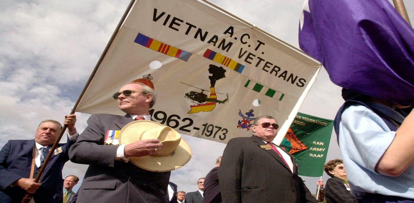 Do the holes in the banner carried by these Vietnam veterans during an Anzac Day parade in Canberra make any difference?