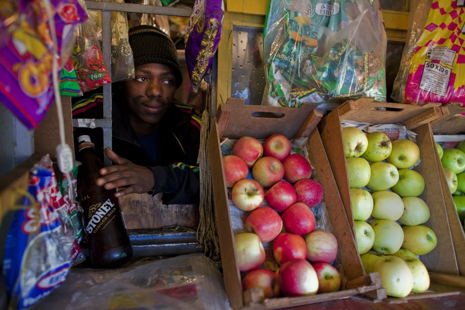 Africas rising middle class time to sort out fact from fiction a street trader looks out from his store in cape town south africa defining people who earn us2 a day as middle class doesnt make sense epanic bothma ccuart Choice Image