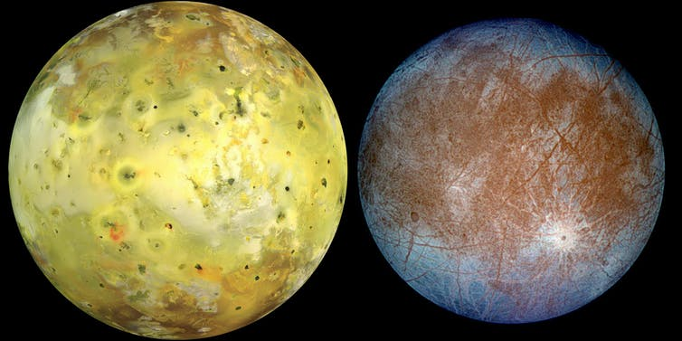 The image shows moons Io and Europa in colour. Io is a bold yellow colour and Europa is icy blue around the edges with a rusty orange colour toward the middle. The surface of Europa appears scratchy.