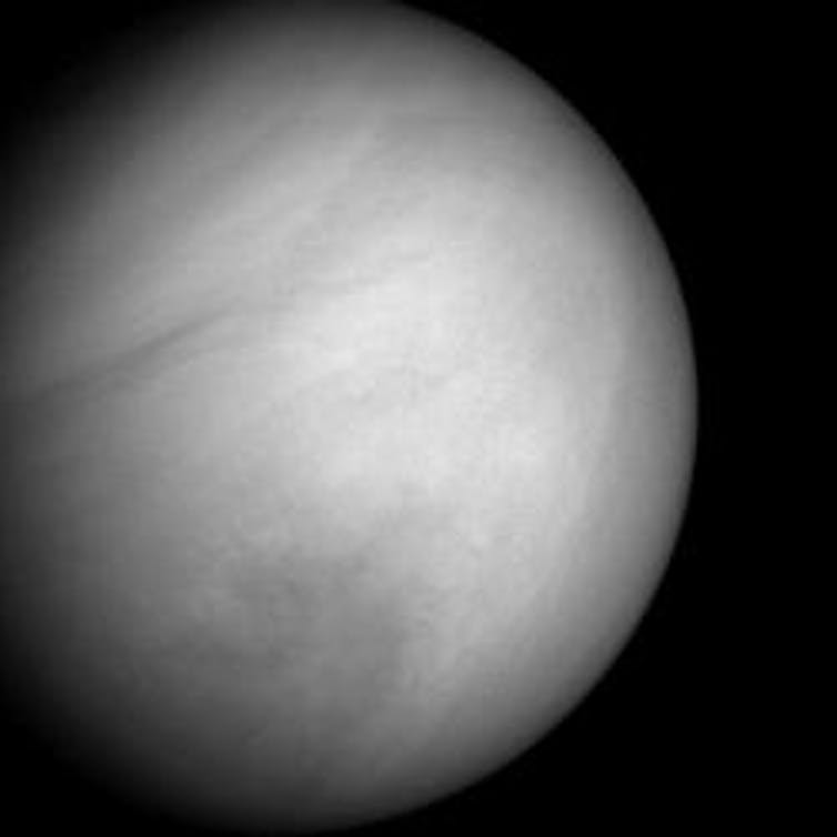 Close-up black and white photo of Venus showing the cloud cover.