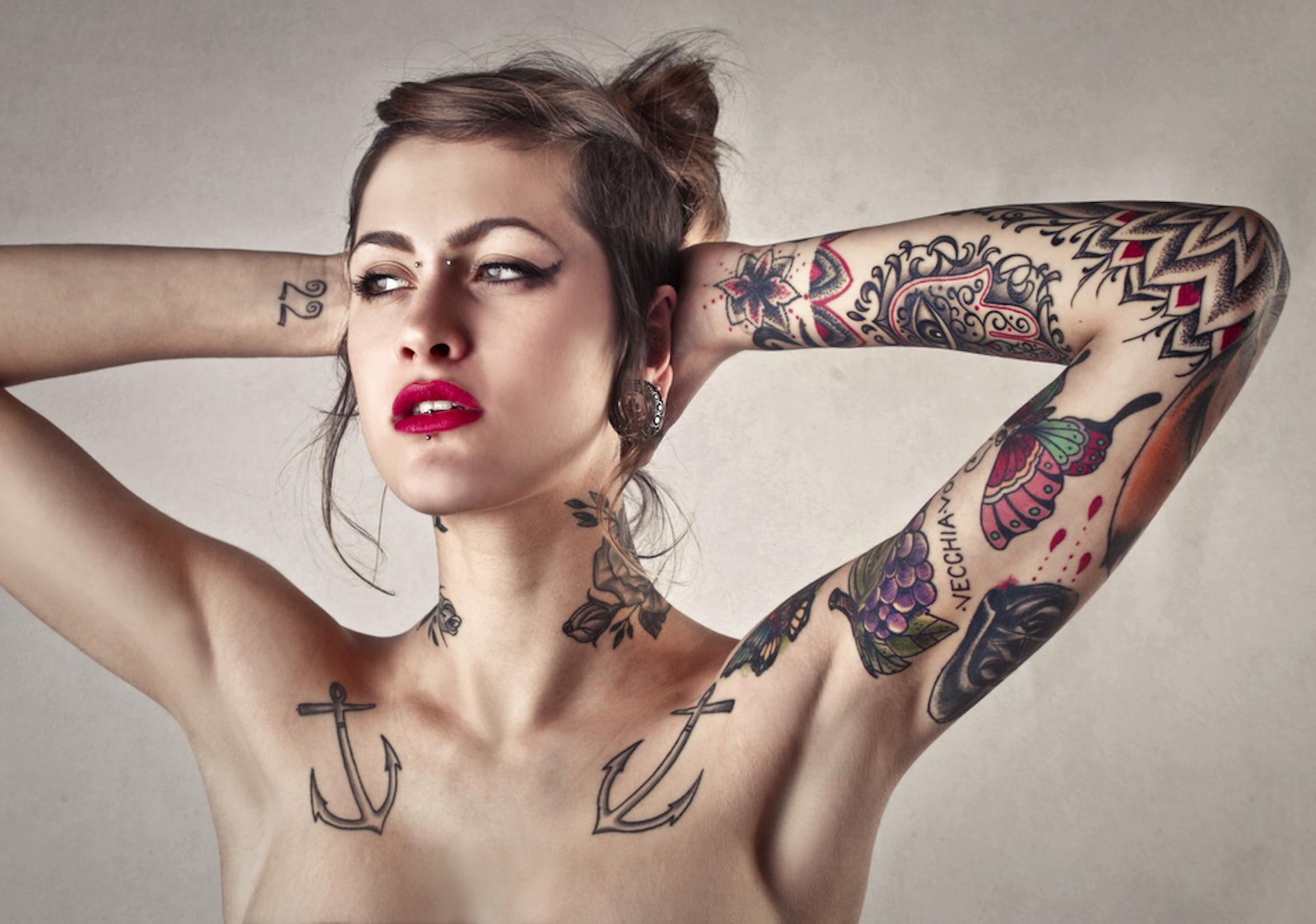 Images - Nude genital tattooed woman