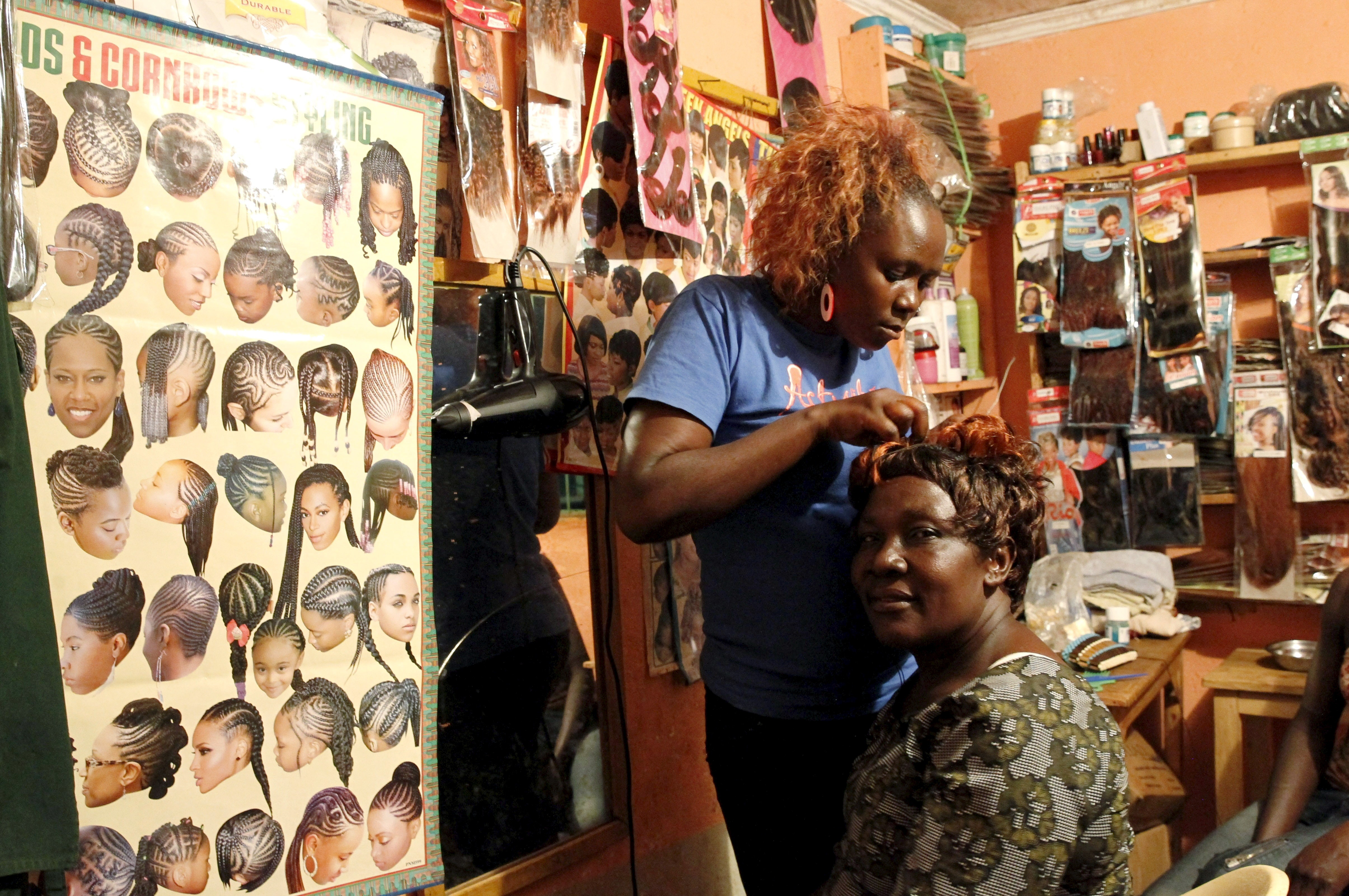 What religion requires women not to cut their hair?