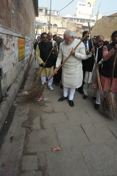 Modi during a cleanliness drive in Assi Ghat Varanasi. Narendra Modi Official/Flickr, CC BY-SA