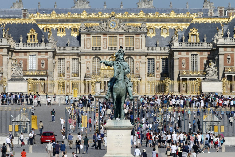 friday essay what is it about versailles  the entrance to the chateau de versailles statue of louis xiv charles platiau reuters
