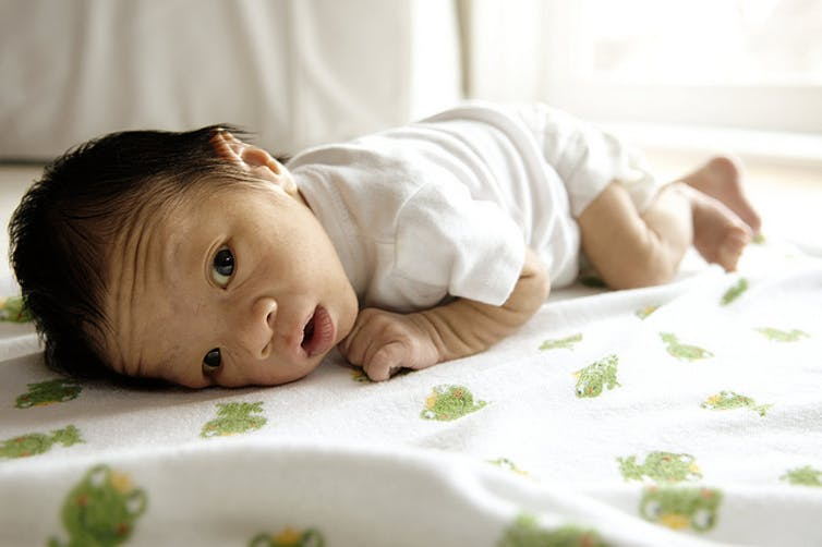 baby-tummy-time-on-the-bed