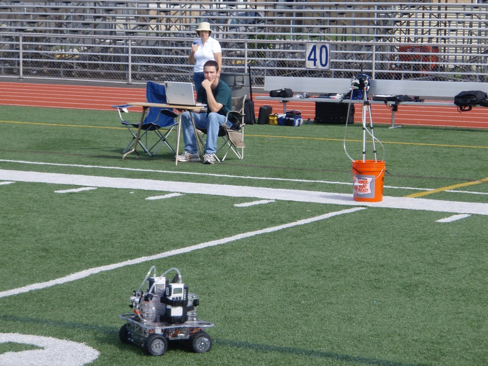 10a85db2cd01 PIPER collecting air sample on artificial turf field. Personal photo