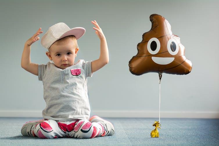 baby-next-to-poo-emoji-balloon