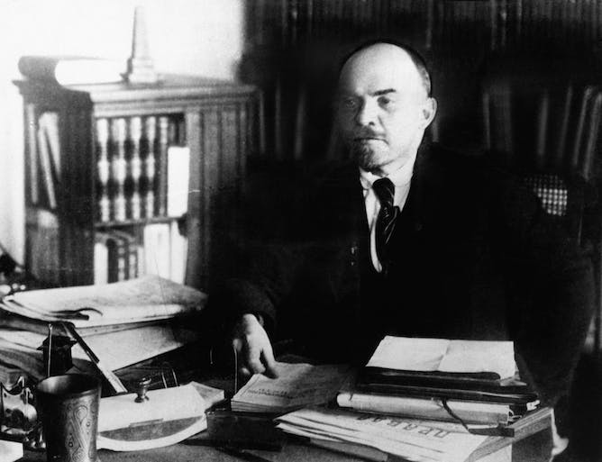 friday essay putin memory wars and the th anniversary of the vladimir lenin at his desk circa 1920 everett historical shutterstock