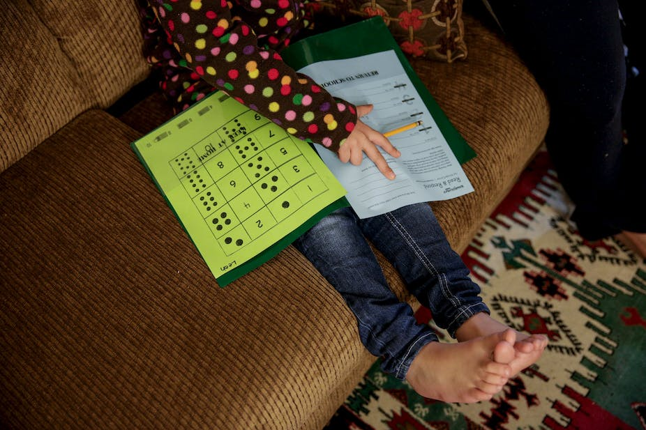 Five year old Syrian refugee Leen works on her homework in Sacramento in November       REUTERS Max Whittaker