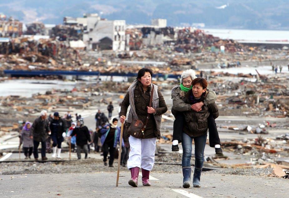 Survivors leave Tohoku a day after the March 11, 2011 earthquake and tsunami.