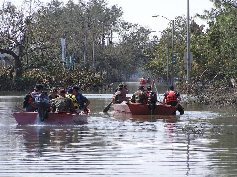 Rescue boats ferry people through flooded streets in New Orleans after Hurricane Katrina, September 11, 2005