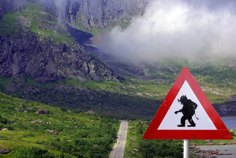 road warning sign of troll