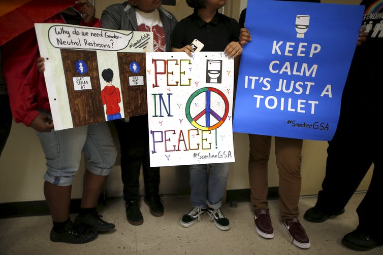 e9d1b0a1 Students holds signs they made to campaign for the first gender-neutral  restroom in the Los Angeles school district at Santee Education Complex  high school ...