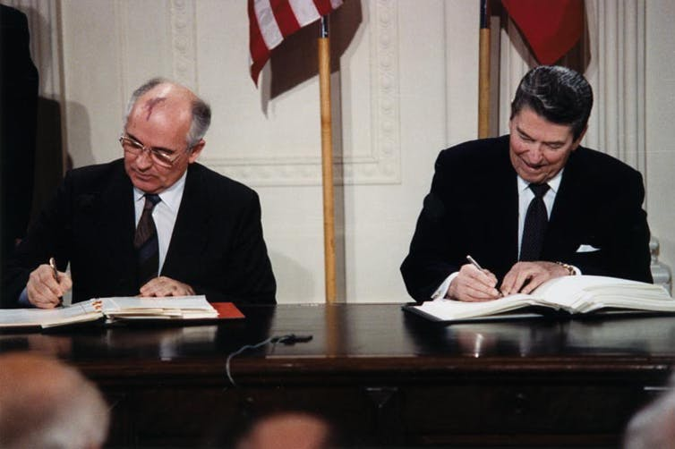 President Reagan and General Secretary Gorbachev signing the INF Treaty in the East Room of the White House. Credit: White House Photographic Office