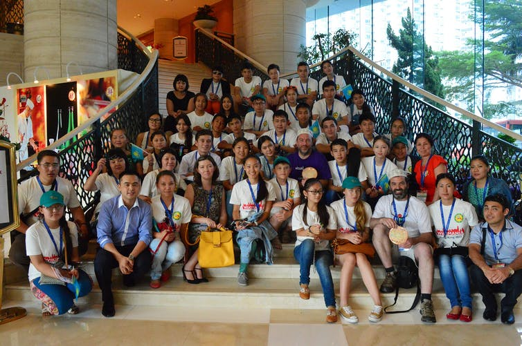 Kazakh students at Wikimania 2013 in Hong Kong. The government supported their study trip to learn to create a Kazakhstan Wikipedia.  Matthew (WMF)/Wikimedia, CC BY-ND