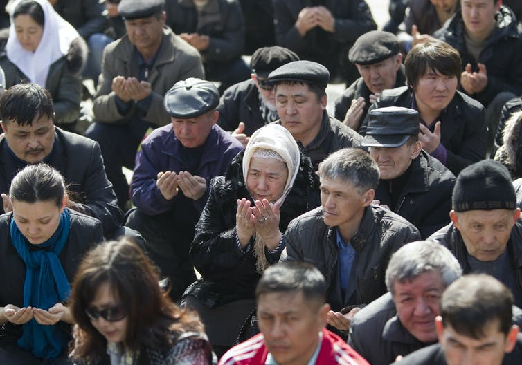 People pray during an opposition rally in Almaty, March 24, 2012. The rally saw violent riots in the western oil town of Zhanaozen. Shamil Zhumatov/Reuters