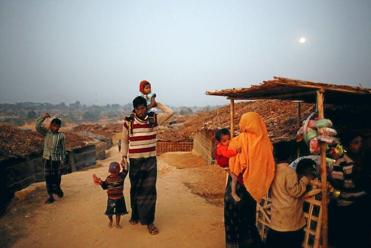 Rohingya refugees return to their makeshift home at Kutupalang Unregistered Refugee Camp, Bangladesh. Mohammad Ponir Hossain/Reuters