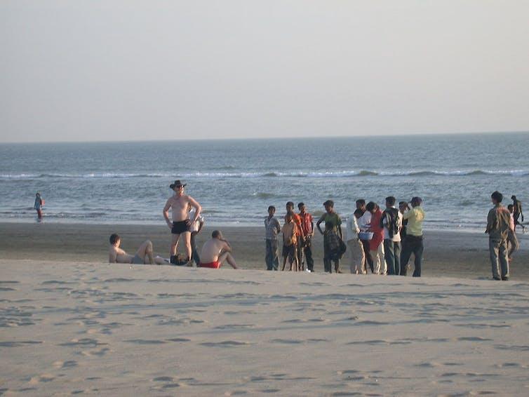 Ukranian tourists attract the attention of locals on Cox's Bazar beach. Credit: Matt Zanon/Wikimedia, CC BY-ND