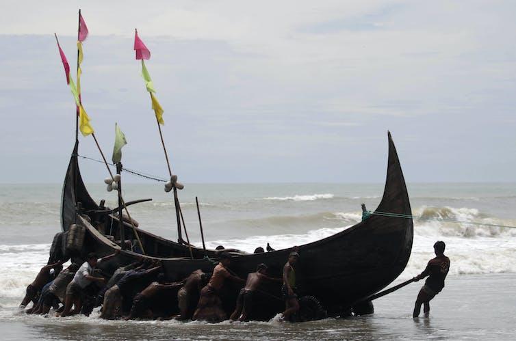 Rohingya fishermen near a refugee camp in Teknaf, 2011. Andrew Biraj/Reuters