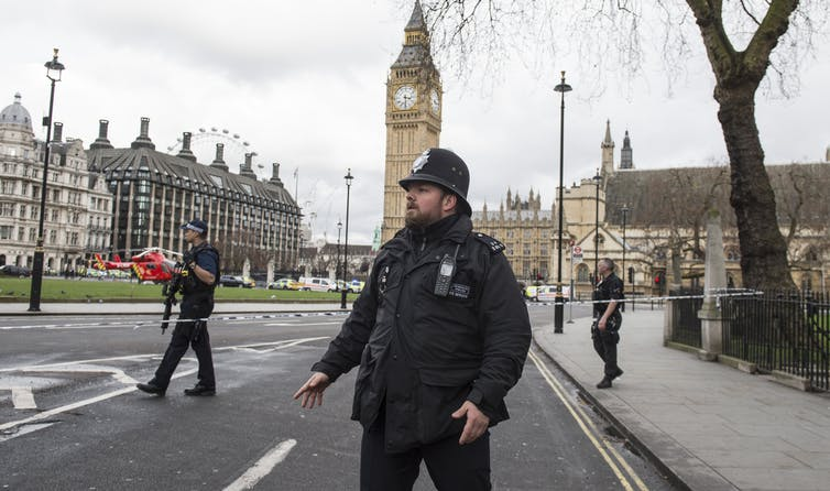 Police secure Parliament Square. EPA