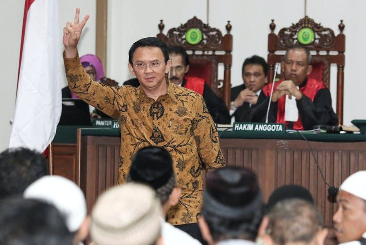 Incumbent Jakarta Governor Basuki 'Ahok' Tjahaja Purnama gestures inside the courtroom during his blasphemy trial. (Reuters Photo/Dharma Wijayanto)
