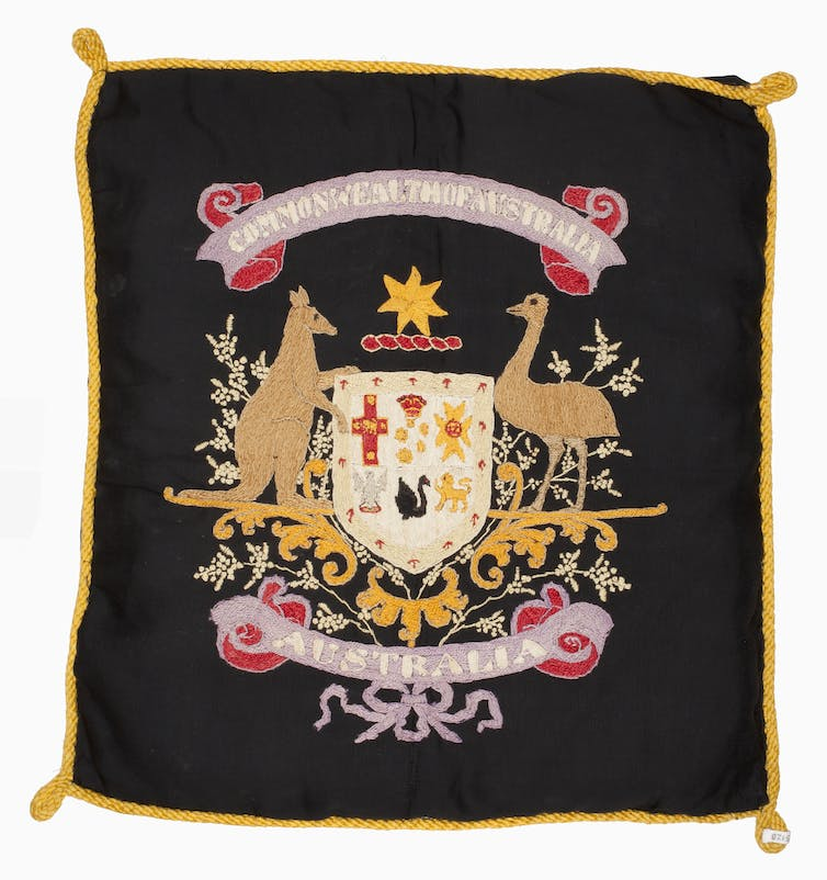 The full cushion bearing the Australian coat of arms sewn by Albert Biggs. Credit: Australian War Memorial/The Conversation