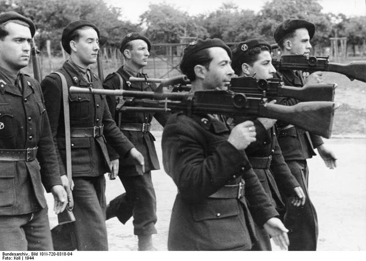 Members of the French militia in 1944, which worked with the Vichy regime and the Germans. Credit: Wikimedia Commons, CC BY-ND