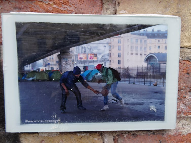 Shooting hoops in a French migrant camp. Credit: jmenj/flickr/The Conversation