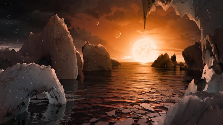 An artist's impression of a sunset on a planet around a red dwarf star.