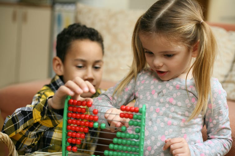 children-playing-with-abacus