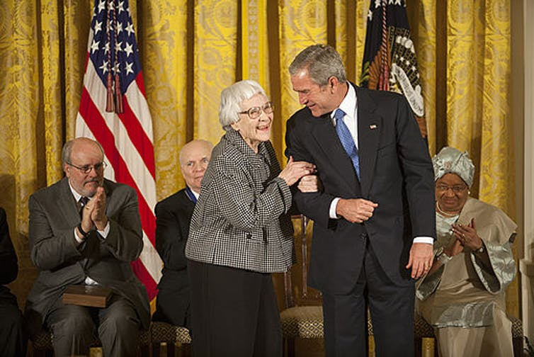Harper Lee being presented with a medal of freedom by President George W Bush in 2007.