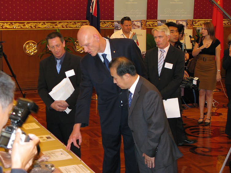 Then Environment Minister, Peter Garrett returns retrieved fossils to China at a ceremony at the Chinese Embassy, Canberra in 2008. John Long, Author provided