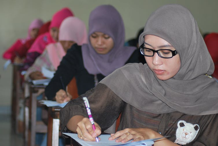 Theology students sit an exam at the Islamic University in Jakarta. Credit: Idris Thaha/The Conversation