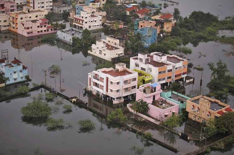 An aerial view shows a flooded residential colony in Chennai on December 6 2015. Anindito Mukherj/Reuters