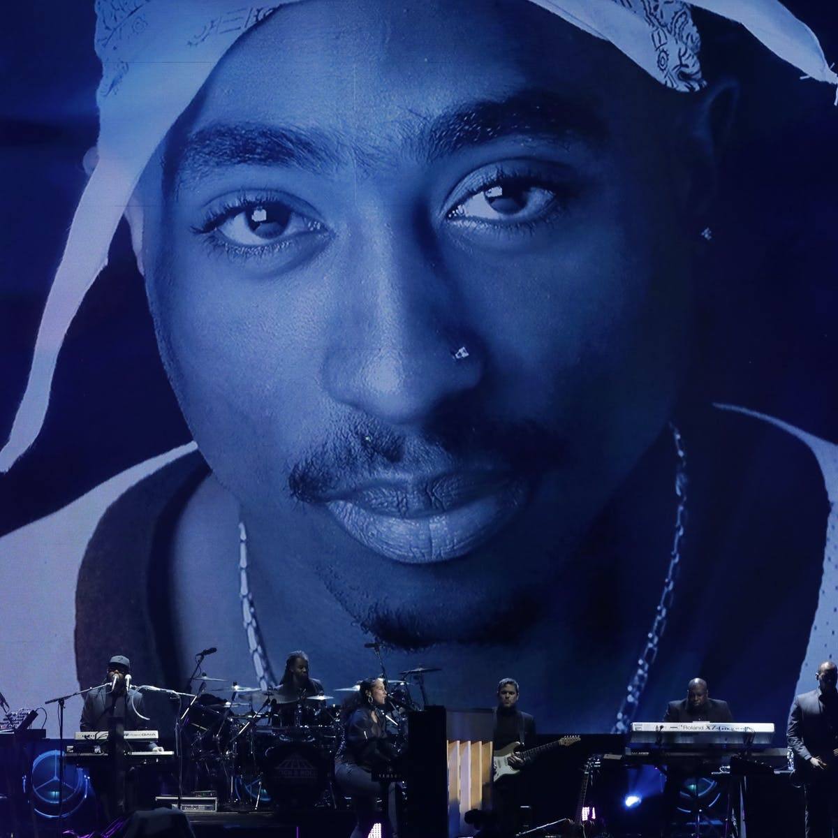 In Tupac's life, the struggles and triumphs of a generation
