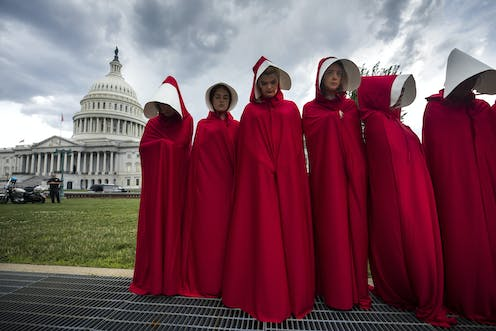 Image result for picture of the women in red handmaids