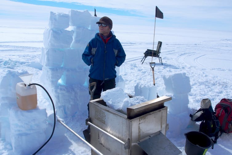 The author prepares to assist his colleague, Bryn Hubbard from Aberystwyth University, in drilling a borehole in Larsen C using pressurised hot water.  MIDAS, Author provided