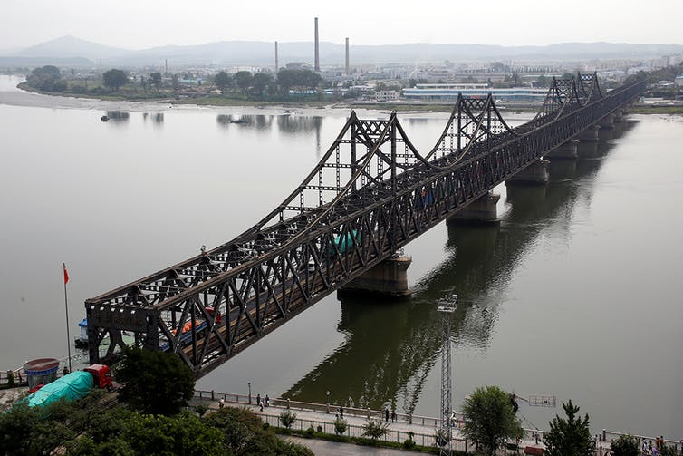 Trucks cross Friendship Bridge from China's Dandong, Liaoning province, to North Korea's Sinuiju. Reuters/Thomas Peter