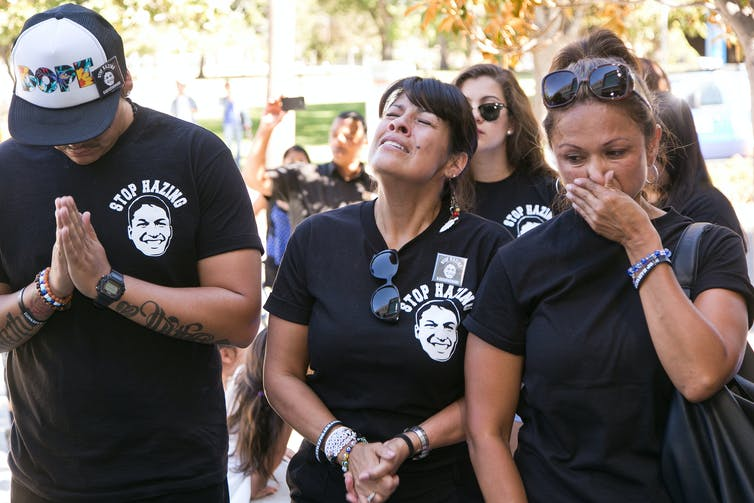 The family of Armando Villa, who died in a Pi Kappa Phi Fraternity hazing incident at California State University, Northridge in 2014, wear anti-hazing shirts at a news conference. (AP Photo/Damian Dovarganes)