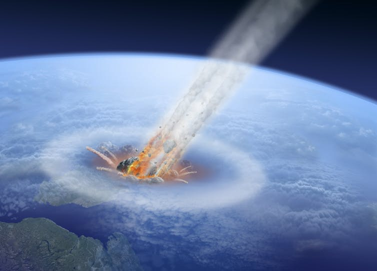 An asteroid smacks into planet Earth.
