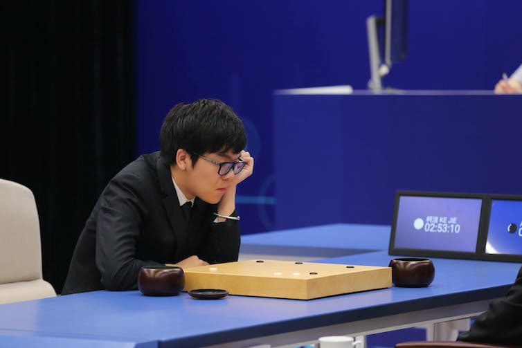 Chinese Go player Ke Jie competes against Google's artificial intelligence program AlphaGo. Reuters/Stringer