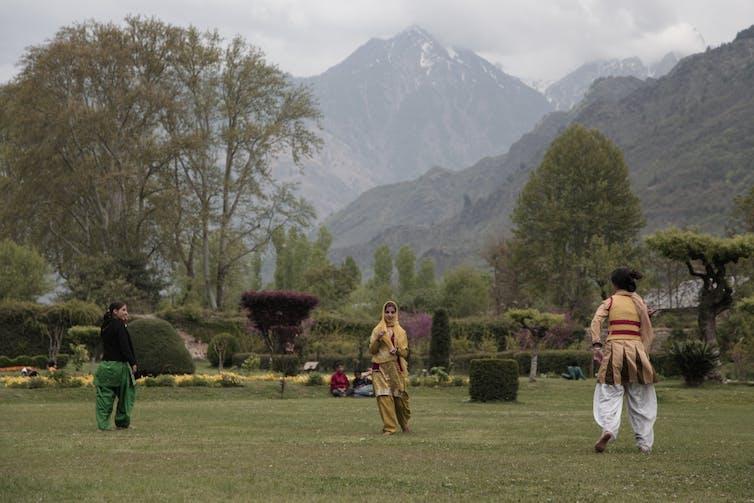 Young Kashmiri women playing catch, Shalimar Gardens, Srinagar, Kashmir. Ben Crowe/ERA Films
