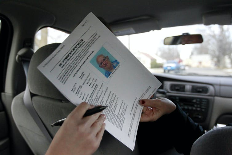 A sex offender registry board image. AP Photo/Steven Senne