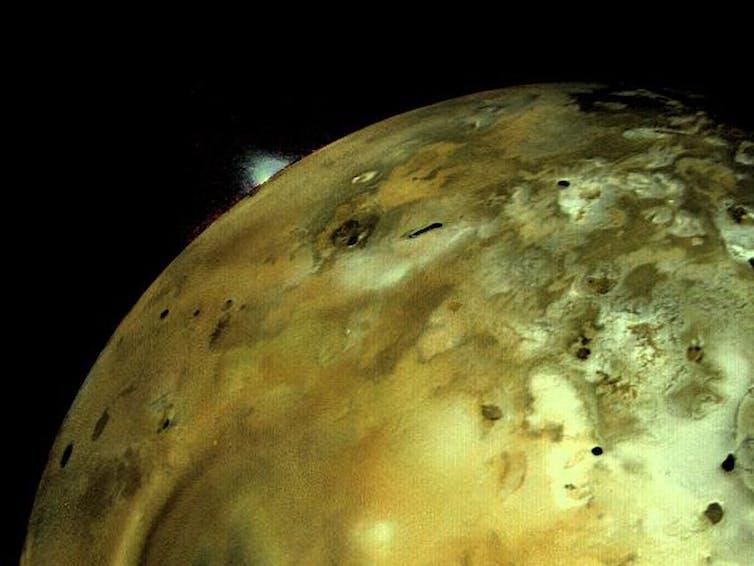 Voyager 1 captures a volcanic eruption on Jupiter's moon Io. NASA/JPL