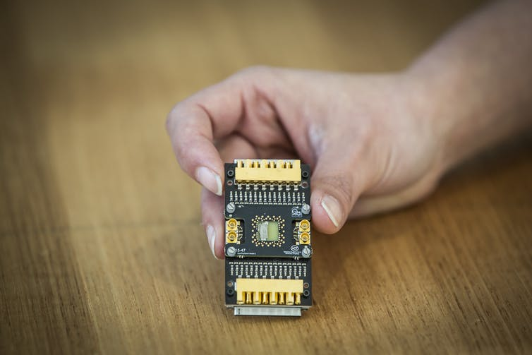 A semiconductor qubit device mounted on a custom cryogenic printed circuit board. Jayne Ion/University of Sydney, Author provided