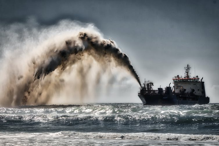 Dredger pumping sand and water to shore for beach renourishment, Mermaid Beach, Gold Coast, Australia, Aug. 20, 2017. Steve Austin, CC BY-SA
