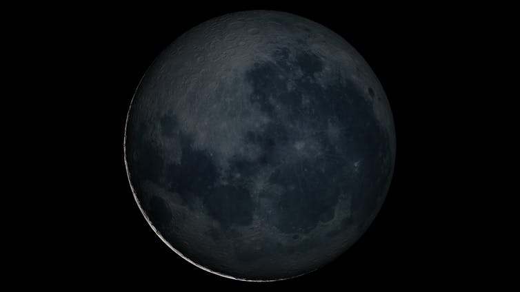 The thin crescent of a new moon.